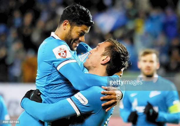 Artem Dzyuba of FC Zenit St Petersburg celebrates his goal with Hulk of FC Zenit St Petersburg during the Russian Football League match between FC...