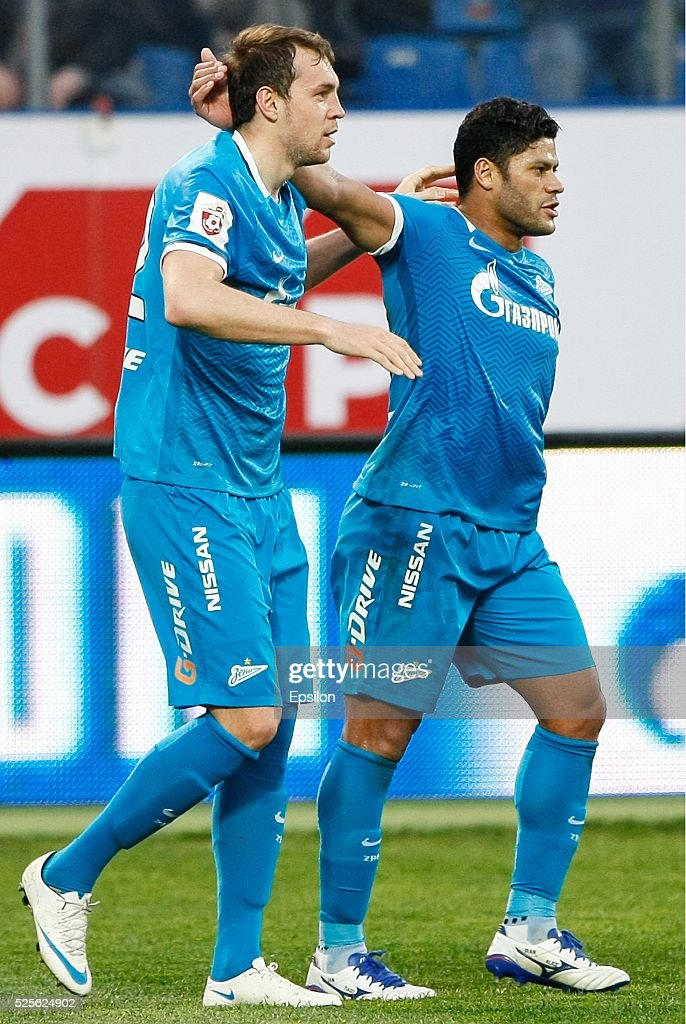 Artem Dzyuba (L) of FC Zenit St. Petersburg celebrates his goal with Hulk of FC Zenit St. Petersburg during the Russian Football League match between FC Zenit St. Petersburg and FC Kuban Krasnodar at Petrovsky stadium on April 28, 2016 in St. Peterburg, Russia.