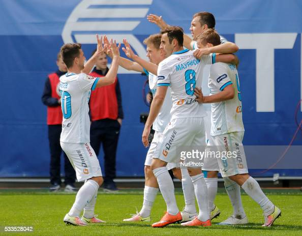 Artem Dzyuba of FC Zenit St Petersburg celebrates his goal with teammates during the Russian Football Premier League match between FC Dynamo Moscow...