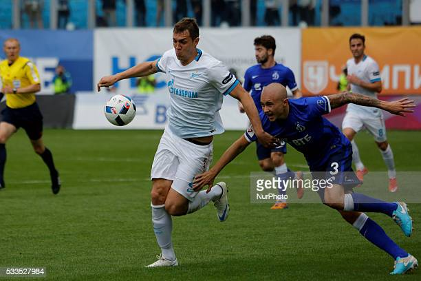 Artem Dzyuba of FC Zenit St Petersburg vies for the ball with Sebastian Holmen of FC Dynamo Moscow during the Russian Football Premier League match...