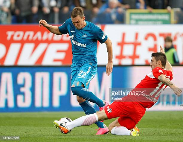 Artem Dzyuba of FC Zenit St Petersburg vies for the ball with Salvatore Bocchetti of FC Spartak Moscow during the Russian Football League match...