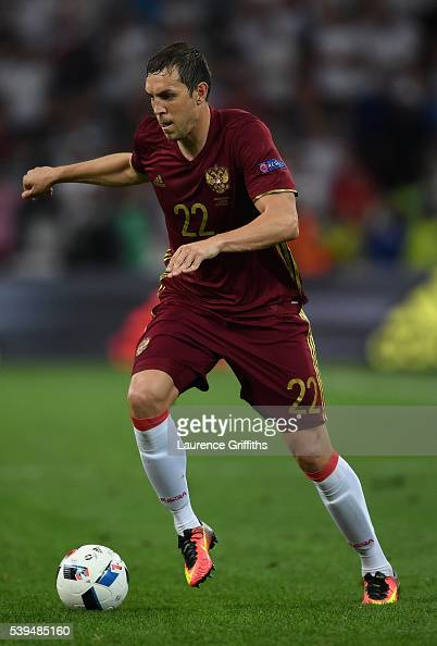 Artem Russia  city photos gallery : Artem Dzyuba of Russia runs with the ball during the UEFA EURO 2016 ...
