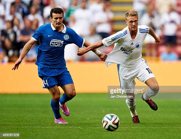 Artem Fedetskiy of FC Dnipro Dnipropetrovsk and Nicolai Jorgensen of FC Copenhagen compete for the ball during UEFA Champions League Third Qualifying...