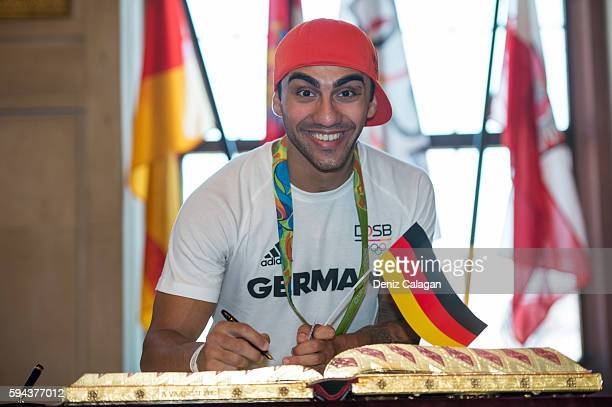 Artem Harutyunyan bronze medalist boxer signs the golden book of Frankfurt on August 23 2016 in Frankfurt am Main Germany