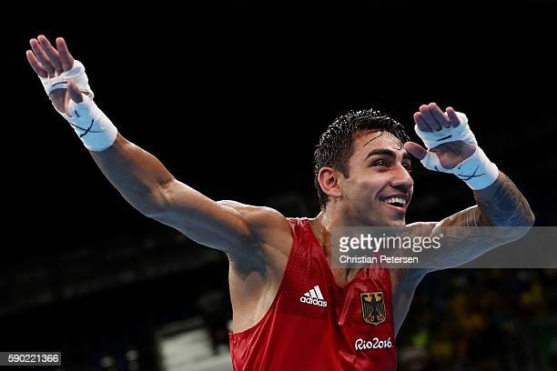 Artem Harutyunyan of Germany celebrates after defeating Batuhan Gozgec of Turkey in the Men's Light Welter Quarterfinal 3 on Day 11 of the Rio 2016...