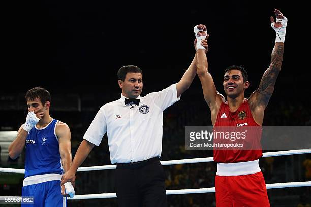 Artem Harutyunyan of Germany celebrates victory over Arthur Biyarslanov of Canada after they compete in their Light Welterweight 64kg men boxing bout...