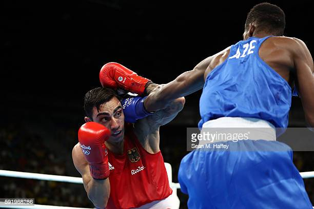 Artem Harutyunyan of Germany fights Lorenzo Sotomayor Collazo of Azerbaijan in the Men's Light Welter 64kg Semifinal 2 on Day 14 of the Rio 2016...