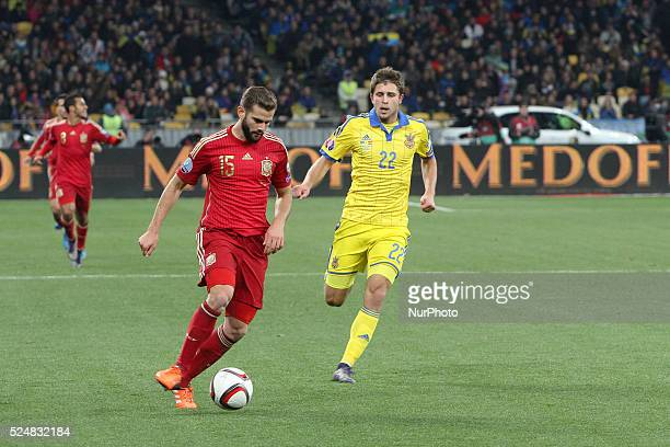 Artem Kravets of Ukraine national team vies with Nacho of Spain during the European Qualifiers 2016 match between Ukraine and Spain national teams at...