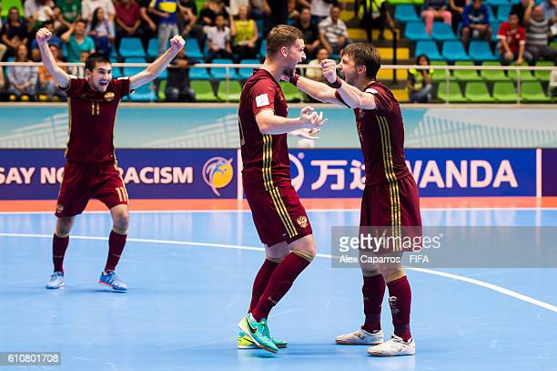 Artem Niiazov Sergei Abramovich and Danil Davydov of Russia celebrate at the end of the FIFA Futsal World Cup SemiFinal match between Iran and Russia...