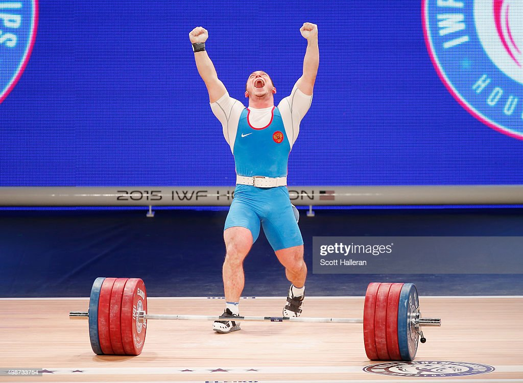 Artem Russia  city photos gallery : Artem Okulov of Russia celebrates a lift in the men's 85kg weight ...