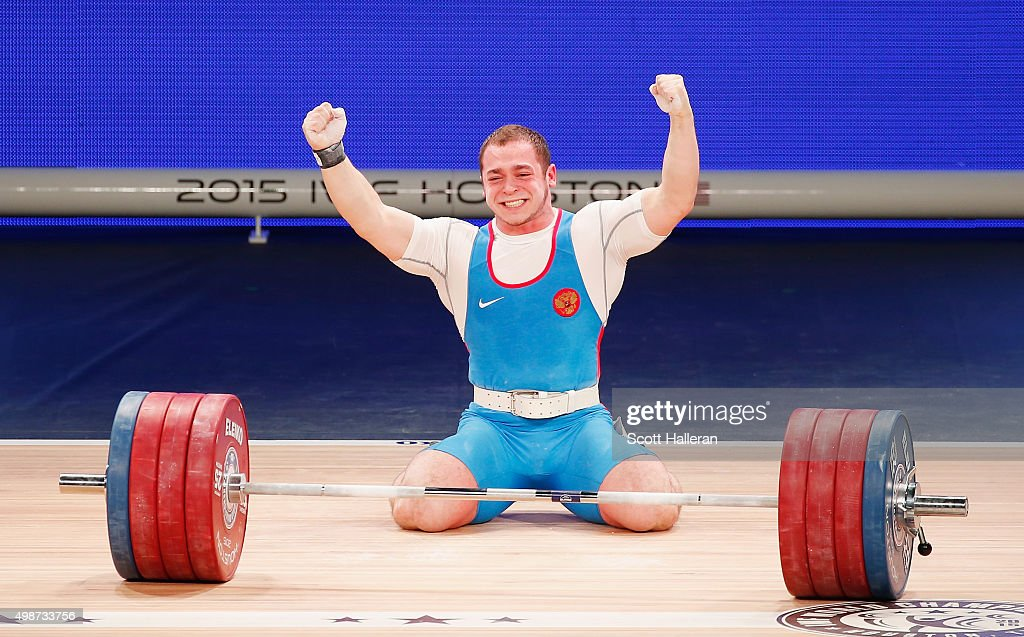 Artem Russia  city photo : Artem Okulov of Russia celebrates a lift in the men's 85kg weight ...