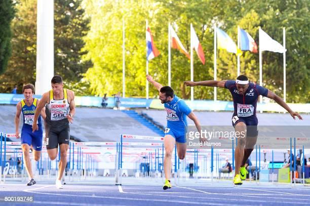 Artem Shamatryn of Ukraine Erik Balnuweit of Germany Lorenzo Perini of Italy and Aurel Manga of France compete in the Men's 110m Hurdles heat 2...