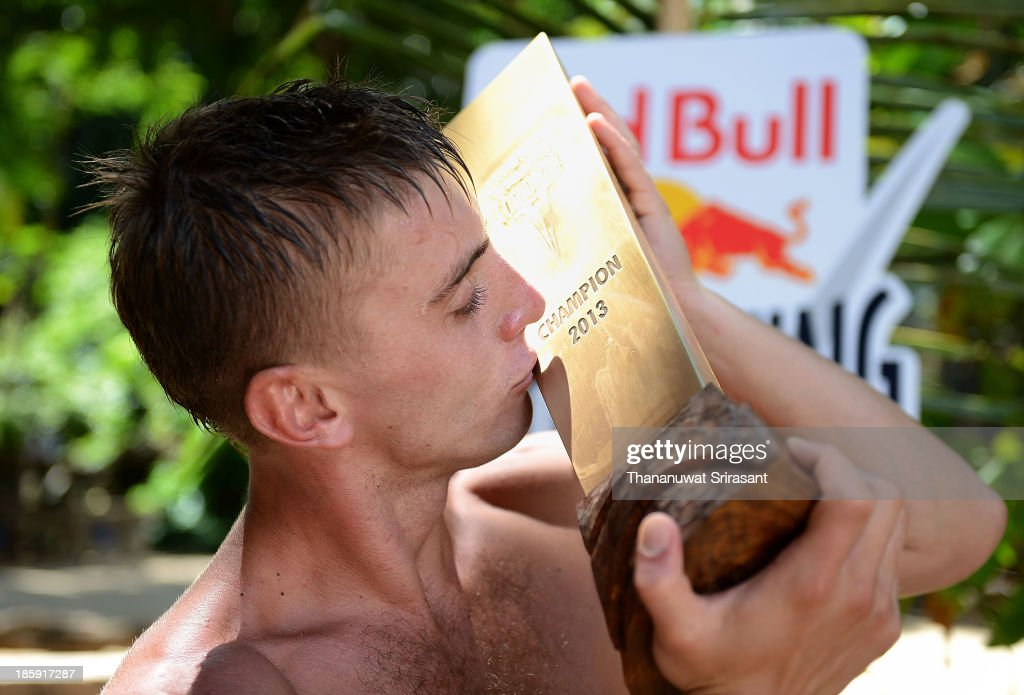 Artem Silchenko of Russia kiss his world series trophy during the last competition day of the eighth and final stop of the 2013 Red Bull Cliff Diving World Series on October 26, 2013 on Hong Island, Thailand.