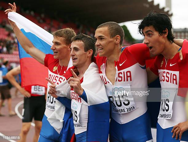 LR0 Artem Vazhov Denis Nesmashnyi Lev Mosin and Nikita Uglov of Russia celebrate team to victory in the Men's 4x400m Final during day four of The...