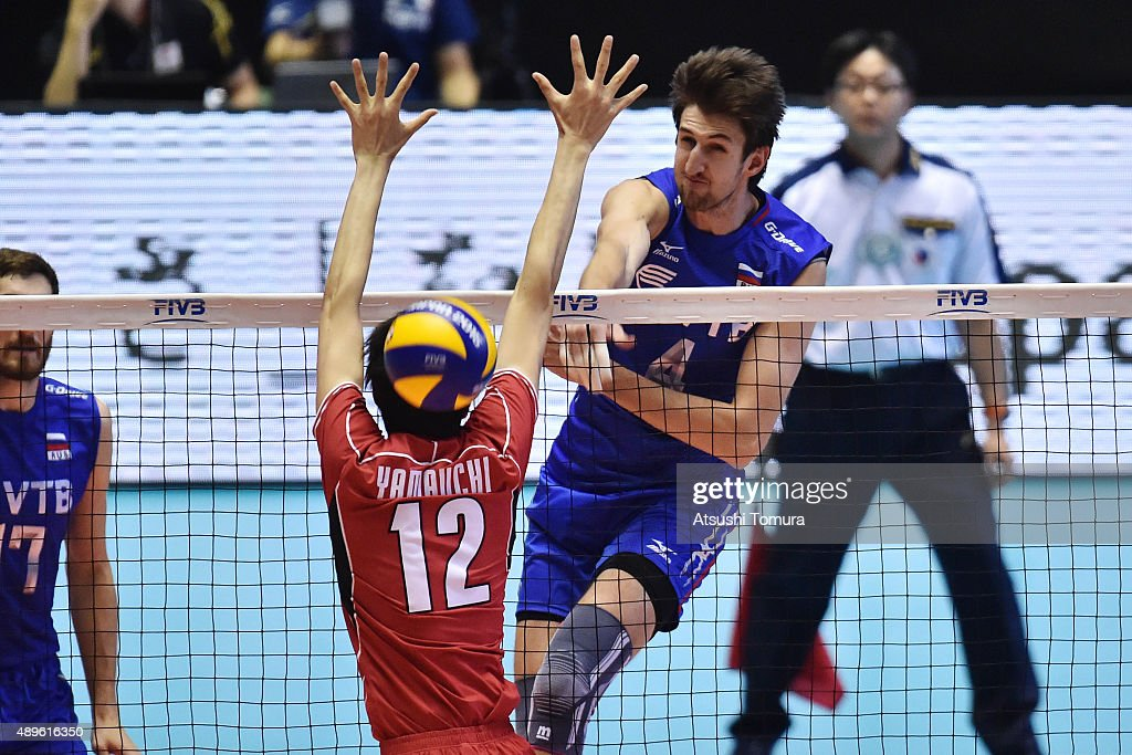 Artem Russia  city photo : Artem Volvich of Russia spikes in the match between Japan and Russia ...