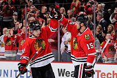 Artemi Panarin and Artem Anisimov of the Chicago Blackhawks celebrate after defeating the St Louis Blues 2 to 0 during the NHL game at the United...