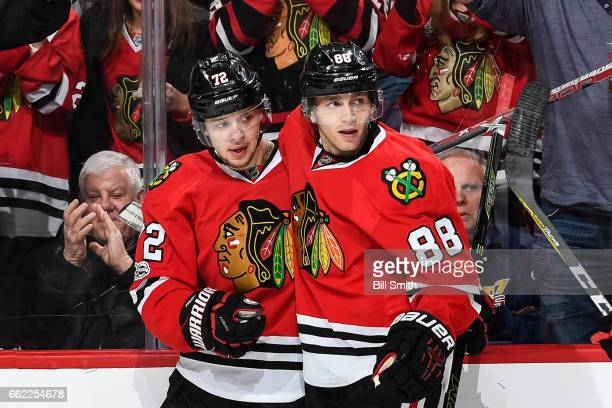 Artemi Panarin and Patrick Kane of the Chicago Blackhawks celebrate after Panarin scored an emptynet goal against the Columbus Blue Jackets in the...