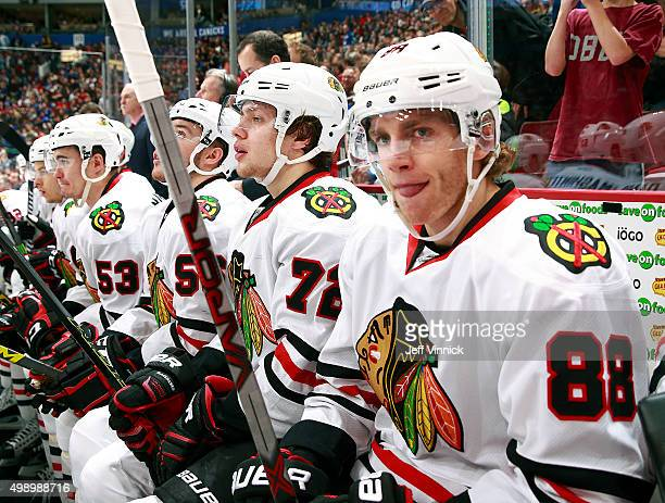 Artemi Panarin and Patrick Kane of the Chicago Blackhawks look on from the bench during their NHL game against the Vancouver Canucks at Rogers Arena...
