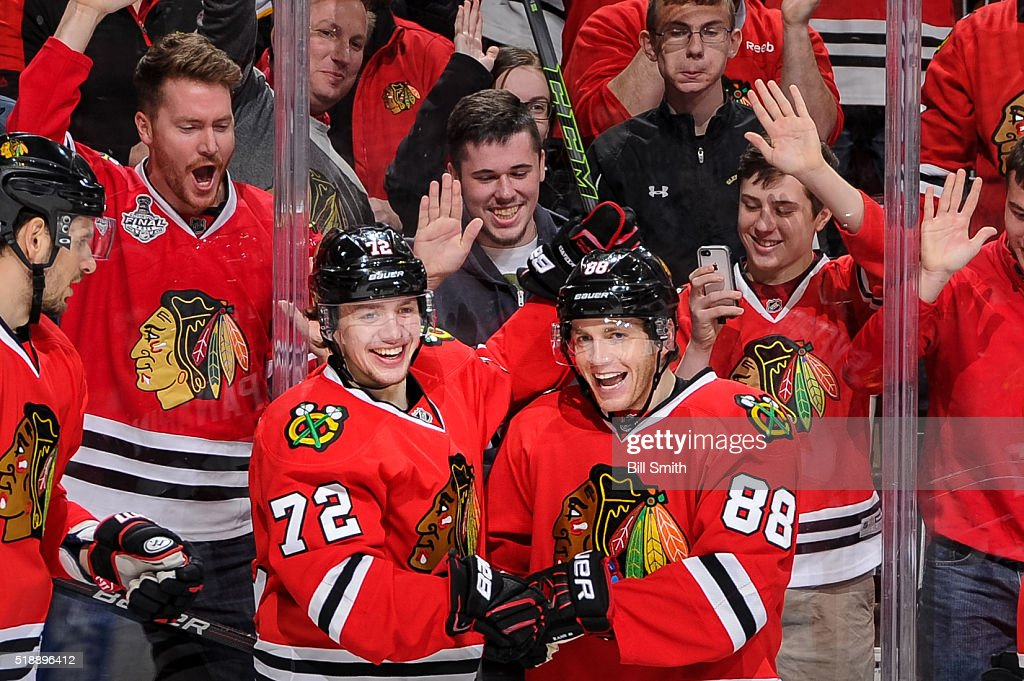 Artemi Panarin #72 and <a gi-track='captionPersonalityLinkClicked' href=/galleries/search?phrase=Patrick+Kane&family=editorial&specificpeople=1977261 ng-click='$event.stopPropagation()'>Patrick Kane</a> #88 of the Chicago Blackhawks (middle) react after Kane scored his second goal of the NHL game against the Boston Bruins in the second period at the United Center on April 3, 2016 in Chicago, Illinois.