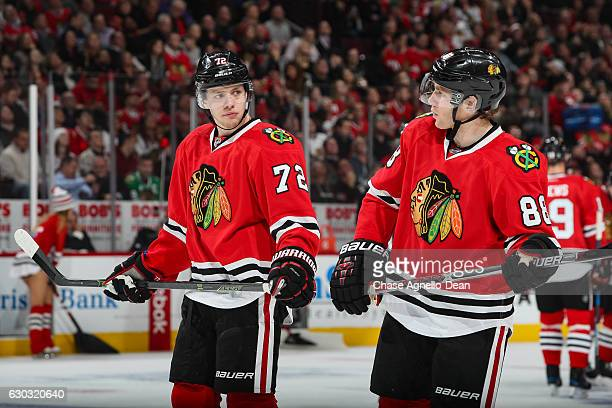 Artemi Panarin and Patrick Kane of the Chicago Blackhawks talk in the second period against the Ottawa Senators at the United Center on December 20...