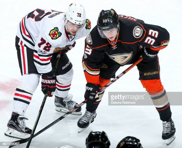 Artemi Panarin of the Chicago Blackhawks and Jakob Silfverberg of the Anaheim Ducks waits for play to begin with a faceoff during the second period...