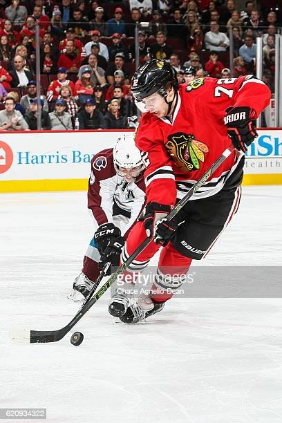 Artemi Panarin of the Chicago Blackhawks and Matt Duchene of the Colorado Avalanche chase the puck in the second period at the United Center on...