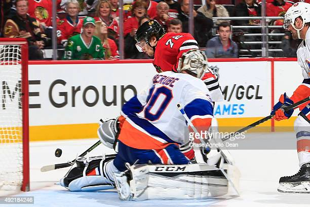 Artemi Panarin of the Chicago Blackhawks attempts to get the puck past goalie JeanFrancois Berube of the New York Islanders in the second period of...