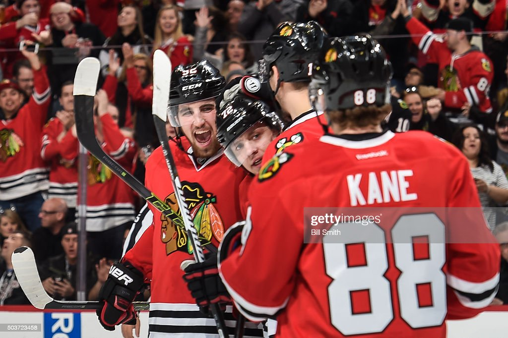 Artemi Panarin #72 of the Chicago Blackhawks (center) celebrates with teammates, including Erik Gustafsson #52, after scoring his second goal of the game against the Pittsburgh Penguins in the third period of the NHL game at the United Center on January 6, 2016 in Chicago, Illinois.
