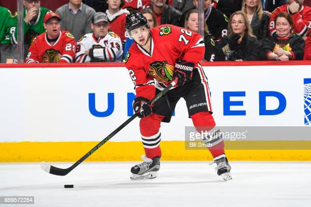 Artemi Panarin of the Chicago Blackhawks controls the puck in the third period against the Vancouver Canucks at the United Center on March 21 2017 in...