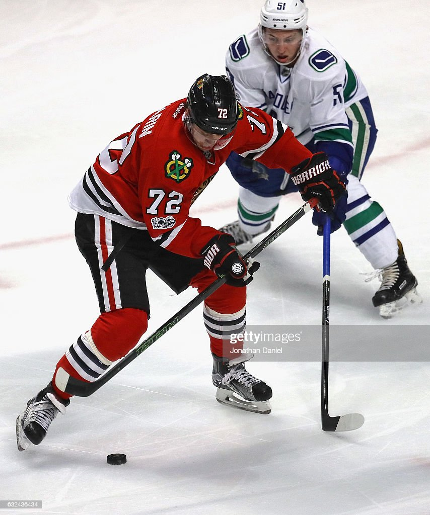 Artemi Panarin #72 of the Chicago Blackhawks controls the puck under pressure from Troy Stecher #51 of the Vancouver Canucks at the United Center on January 22, 2017 in Chicago, Illinois. The Blackhawks defeated the Canucks 4-2.
