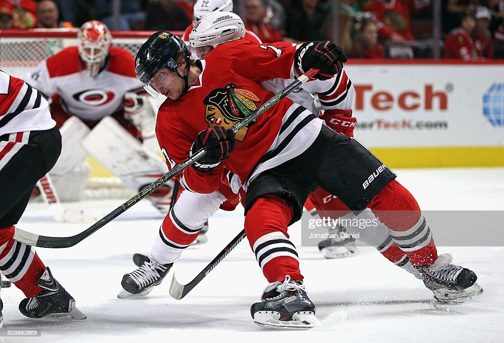 Artemi Panarin #72 of the Chicago Blackhawks dives to the puck on a face-off against the Carolina Hurricanes at the United Center on December 27, 2015 in Chicago, Illinois. The Hurricanes defeated the Blackhawks 2-1.