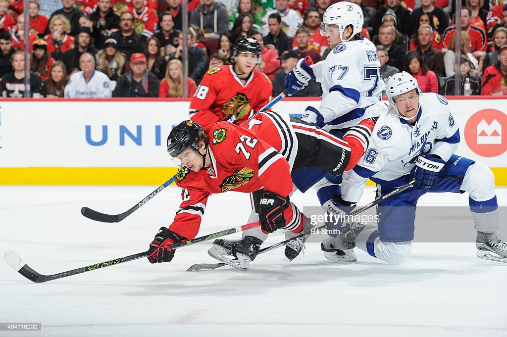 Artemi Panarin #72 of the Chicago Blackhawks falls over <a gi-track='captionPersonalityLinkClicked' href=/galleries/search?phrase=Anton+Stralman&family=editorial&specificpeople=2271901 ng-click='$event.stopPropagation()'>Anton Stralman</a> #6 of the Tampa Bay Lightning in the third period of the NHL game at the United Center on October 24, 2015 in Chicago, Illinois.