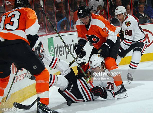 Artemi Panarin of the Chicago Blackhawks is taken down by Brandon Manning of the Philadelphia Flyers during the third period at the Wells Fargo...