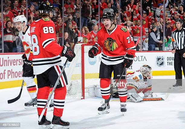 Artemi Panarin of the Chicago Blackhawks reacts after scoring against the Calgary Flames in the second period of the NHL game at the United Center on...