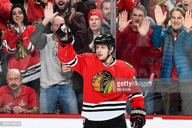 Artemi Panarin of the Chicago Blackhawks reacts after scoring against the Ottawa Senators in the first period at the United Center on December 20...