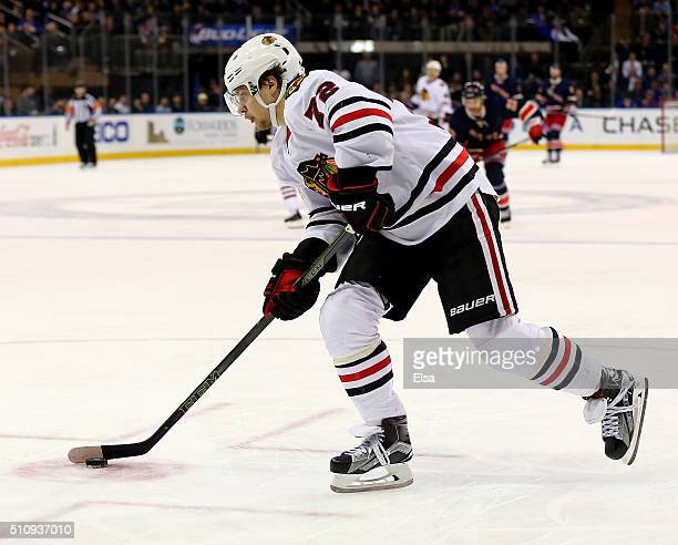 Artemi Panarin of the Chicago Blackhawks scores a hat trick with this goal in the third period against the New York Rangers at Madison Square Garden...