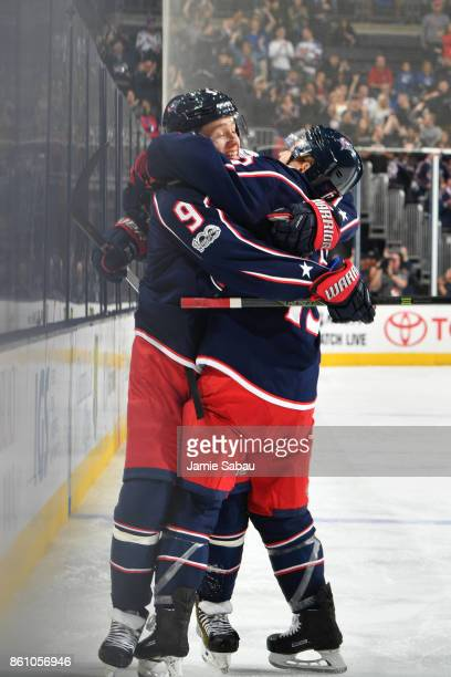 Artemi Panarin of the Columbus Blue Jackets celebrates his third period goal with teammate Cam Atkinson of the Columbus Blue Jackets during a game...