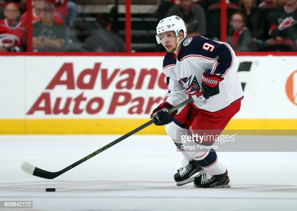 Artemi Panarin of the Columbus Blue Jackets controls the puck during an NHL game against the Carolina Hurricanes on October 10 2017 at PNC Arena in...