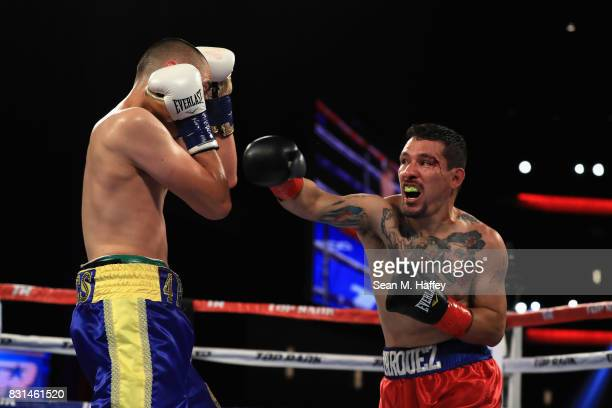 Artemio Reyes exchanges punches with Steve Marquez during their Welterweight fight at the Microsoft Theater on August 5 2017 in Los Angeles California