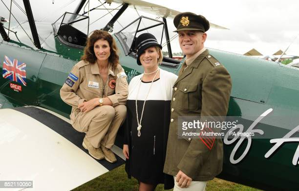 Artemis ambassador Zara Phillips and her husband Mike Tindall pose next to 'The Spirit of Artemis' a 1942 Boeing Stearman 75 alongside her pilot...