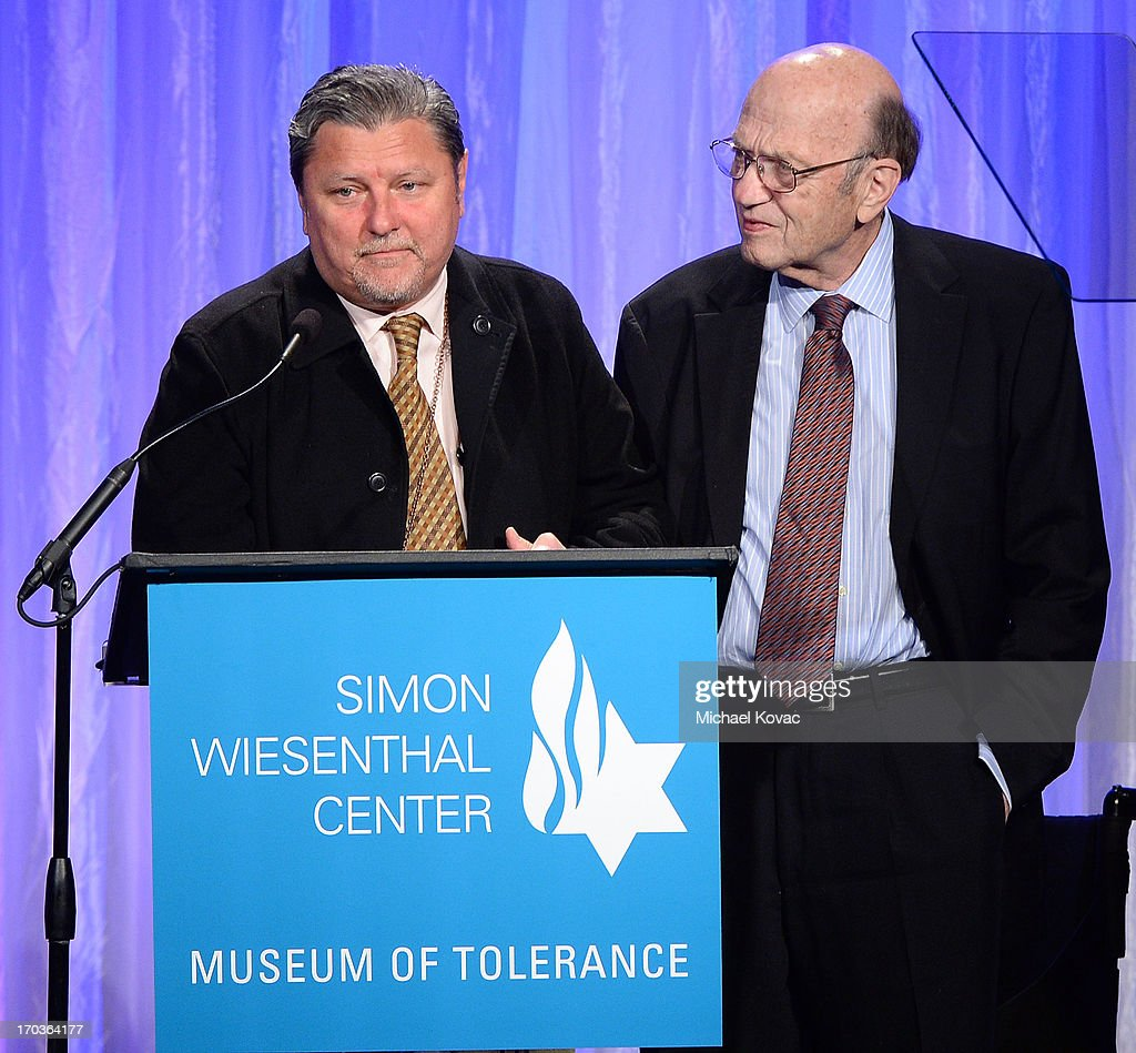 Artemis Joukowsky III (L) is accompanied by Dr. Alex Strasser onstage at the Simon Wiesenthal Center National Tribute Dinner at Regent Beverly Wilshire Hotel on June 11, 2013 in Beverly Hills, California.