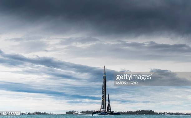 TOPSHOT Artemis Racing skippered by Nathan Outteridge races during the 35th America's Cup Louis Vuitton Challenger Playoffs finals in Hamilton...