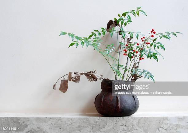 Artesanal vase in an ikebana fall style.