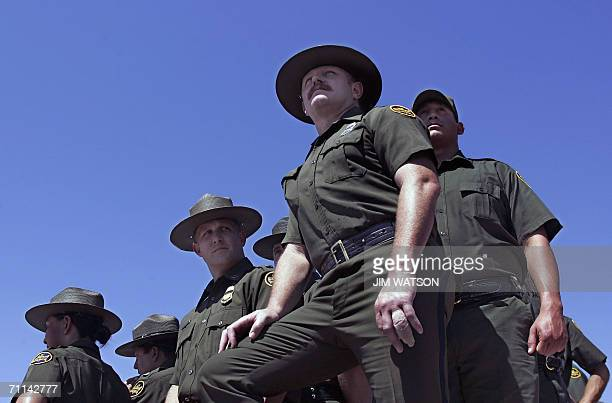 US Border Patrol Agents await the arrival of US President George W Bush 06 June 2006 the Federal Law Enforcement Training Center in Artesia NM Bush...