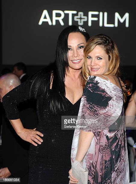 ArtFilm Gala CoChair Eva Chow wearing Gucci and actress Drew Barrymore attend the LACMA 2013 Art Film Gala honoring Martin Scorsese and David Hockney...