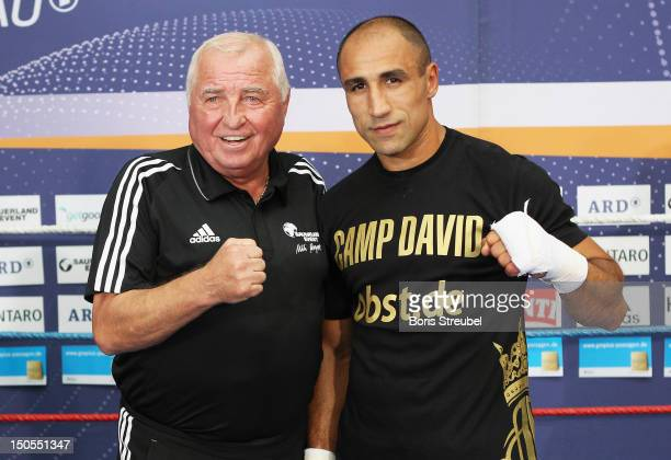 Arthur Abraham and his coach Uli Wegner pose during a public training session at Gropius Passagen on August 21 2012 in Berlin Germany