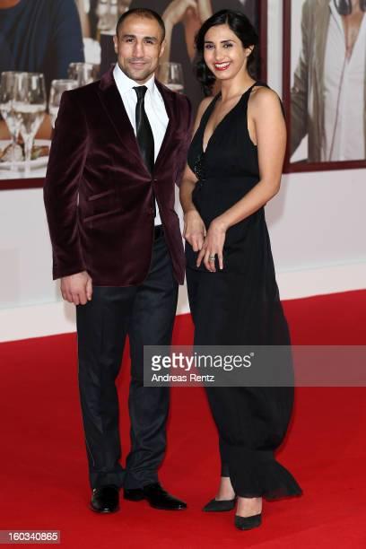 Arthur Abraham and partner attend 'Kokowaeaeh 2' Germany Premiere at Cinestar Potsdamer Platz on January 29 2013 in Berlin Germany