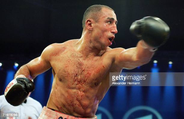 Arthur Abraham fights with a broken jaw during the IBF World Championship Middleweight fight between Arthur Abraham of Germany and Edison Miranda of...
