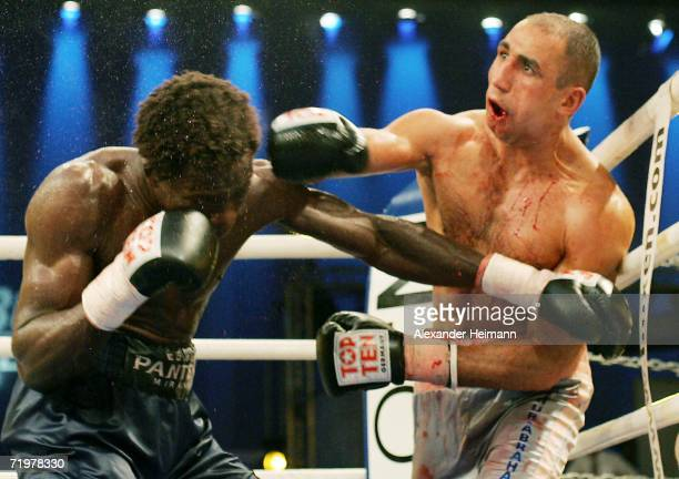Arthur Abraham landsn a punch on Edison Miranda during the IBF World Championship Middleweight fight between Arthur Abraham of Germany and Edison...