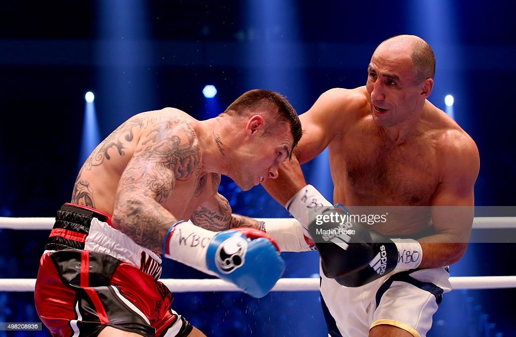 Arthur Abraham of Germany and Martin Murray of Great Britain exchange punches during the WBO World Championship Super Middleweight title fight at TUI...